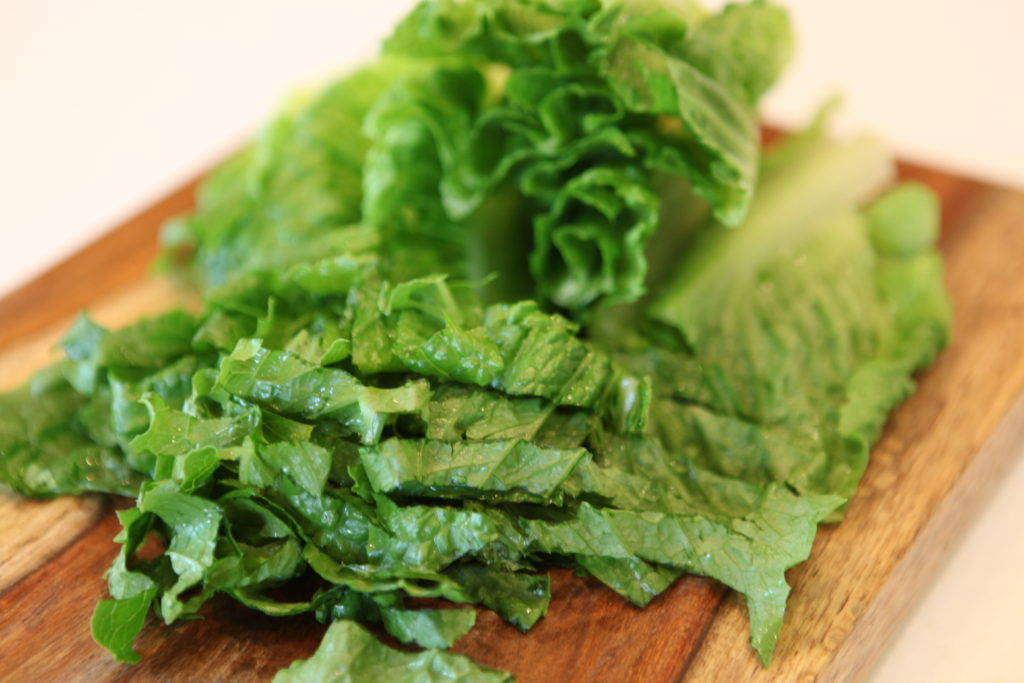 Start by chopping your lettuce into bite-sized pieces.