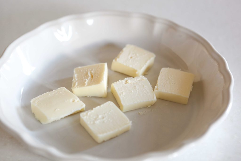 Melt 6 tablespoons of butter.