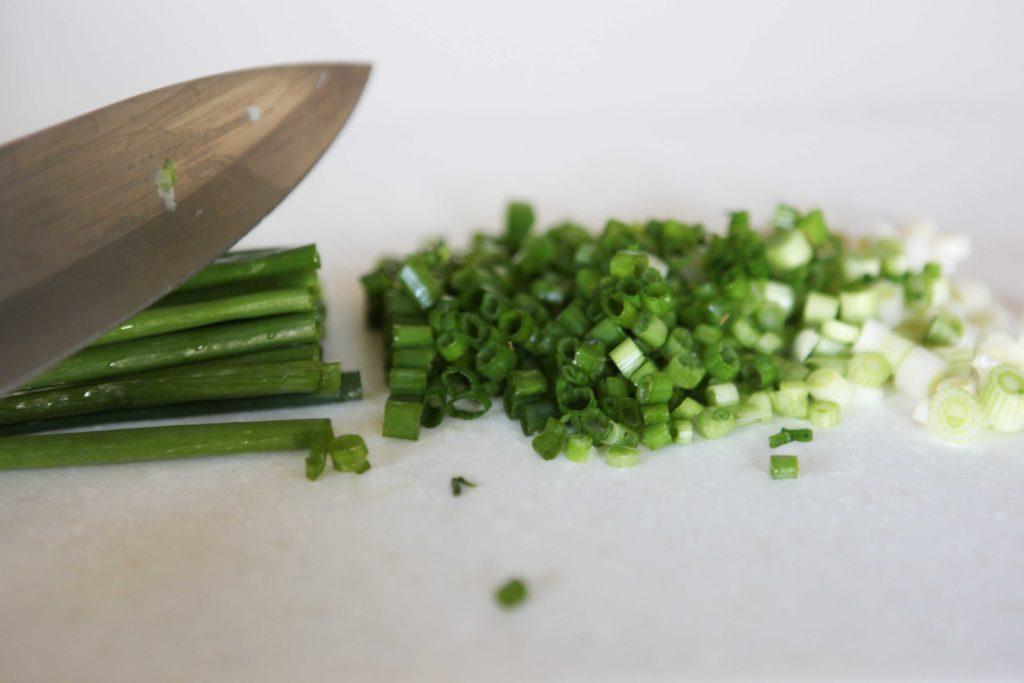 Chop green onions.