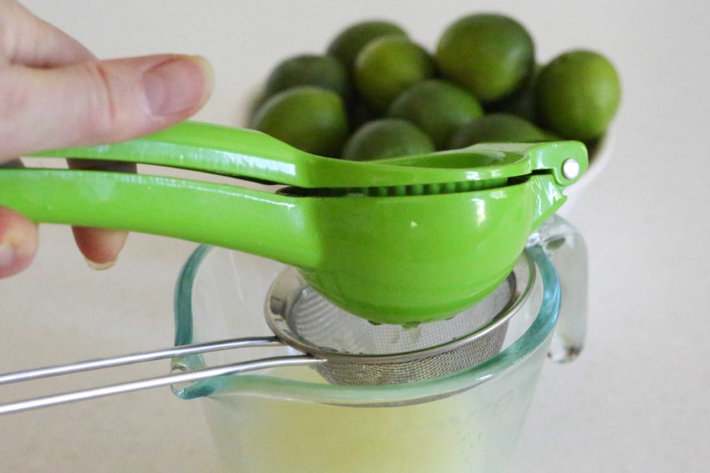 Cut the limes in half, and squeeze out 1/2 cup of juice.