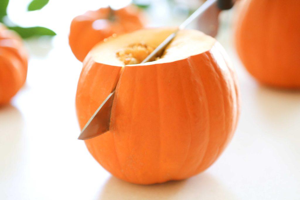 preparing sugar pumpkins to make pumpkin puree