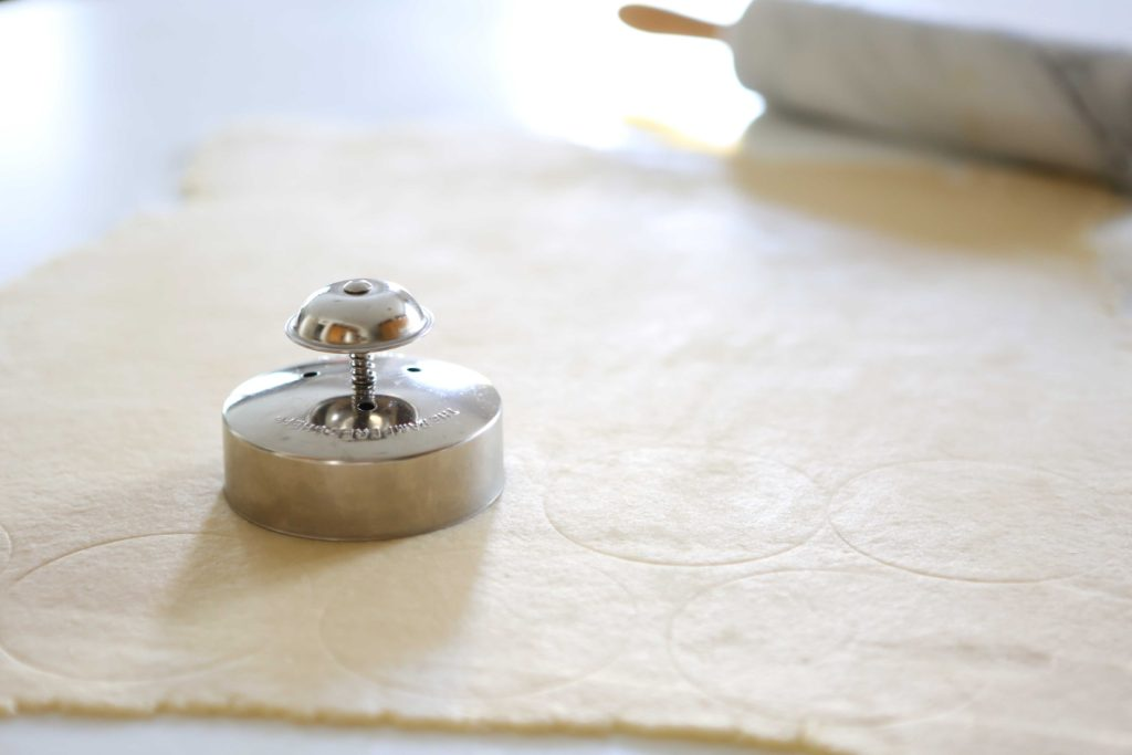 Use a cutter or knife to make light marks on half of the pastry dough.