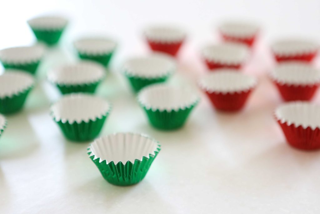 Lay out several small paper candy cups.