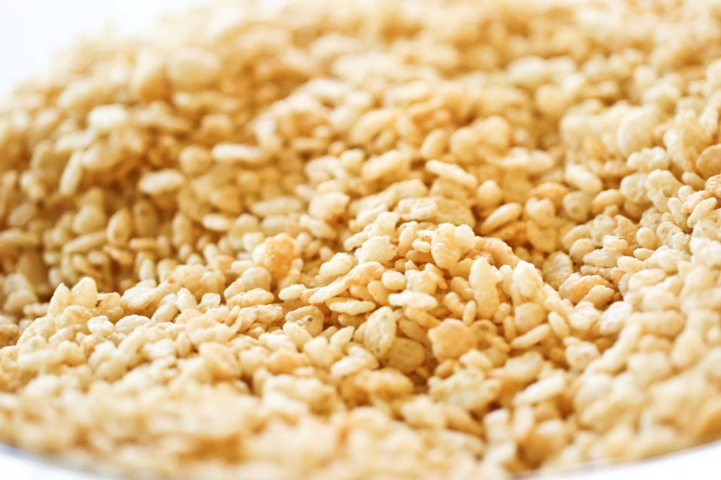 In a large mixing bowl, measure 7 ½ cups Rice Krispies cereal Set aside.