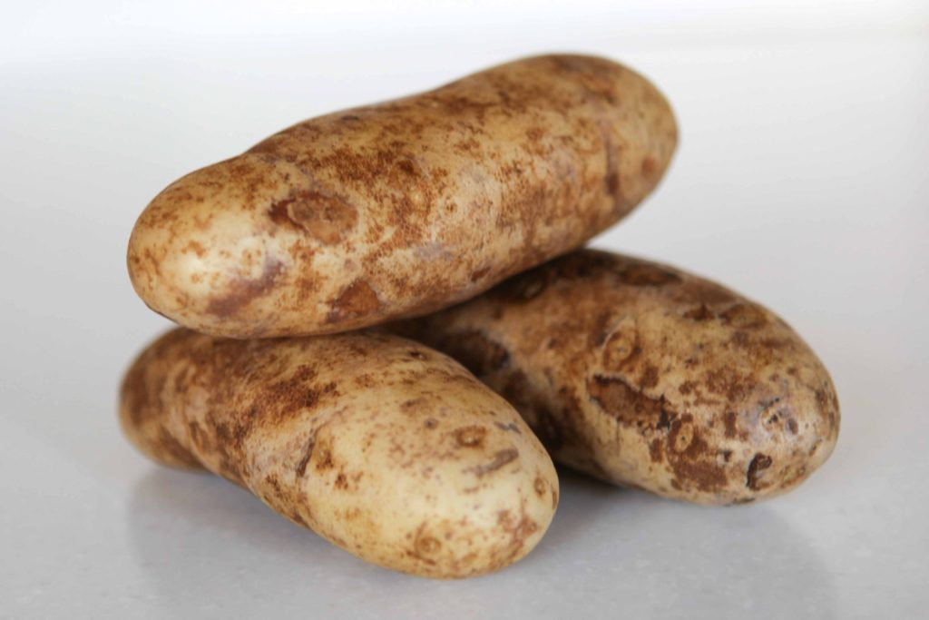 Thoroughly wash and dry the potatoes