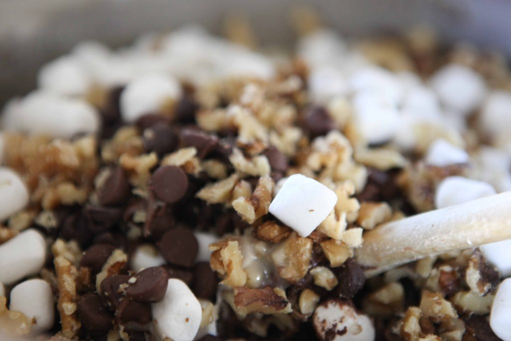 Stir in chocolate chips, marshmallows, nuts, and vanilla, and combine completely.