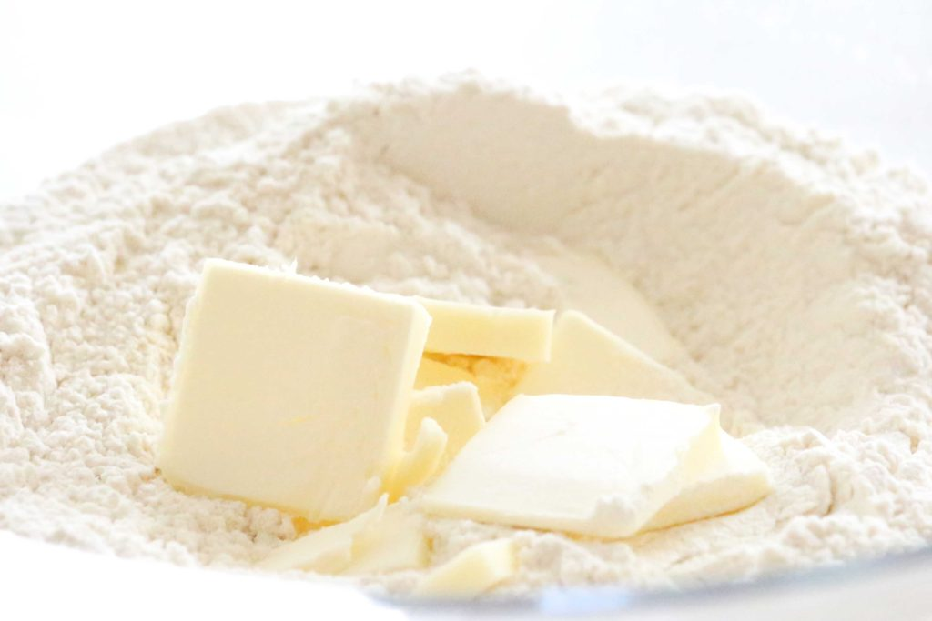 To the flour mixture, add: 4 tablespoons butter, cut into pieces