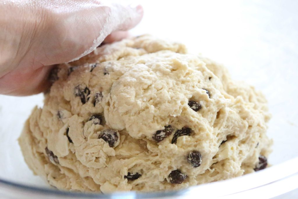 Then lightly dust your hands with flour, and form a rough ball with the dough. Do NOT over-knead.