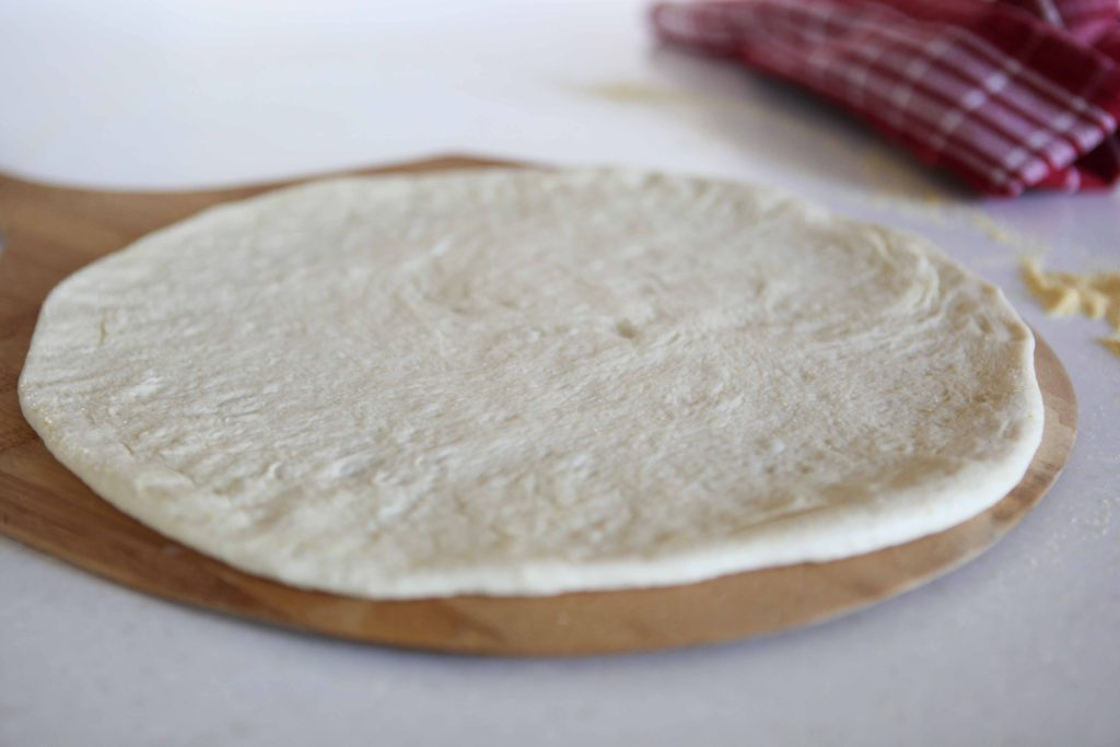 Lay the circle on the prepared pizza peel.