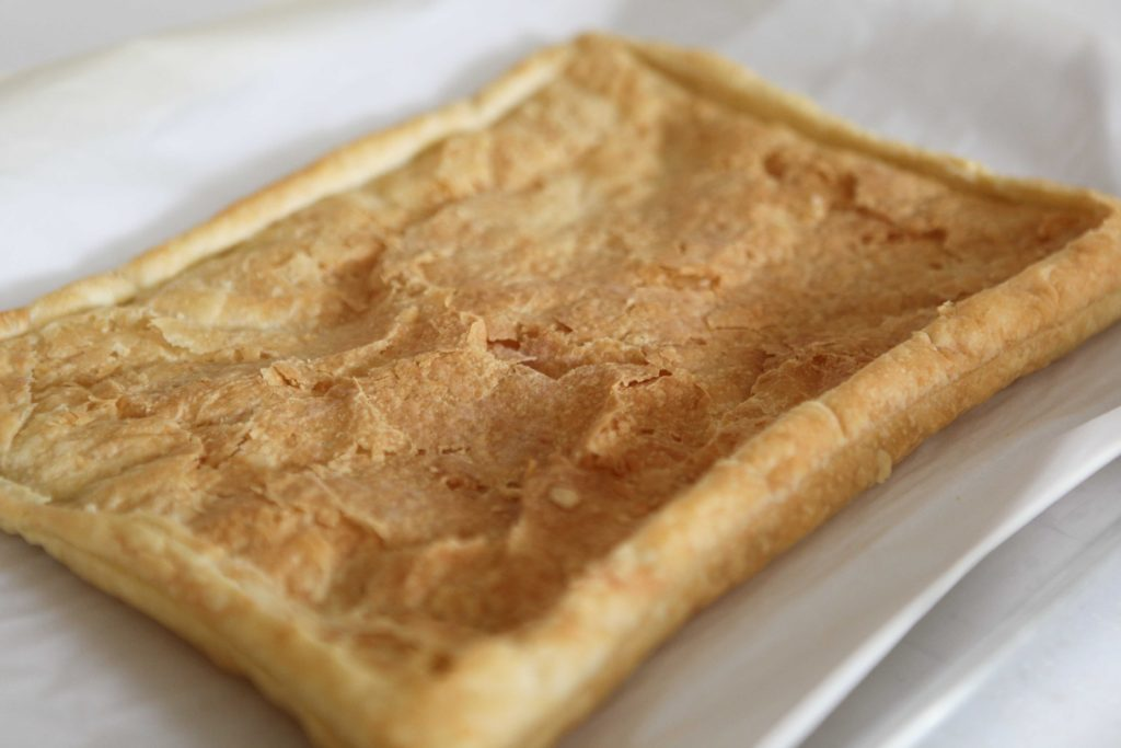 Remove from oven, and if the center has puffed too much, gently flatten with a spatula.