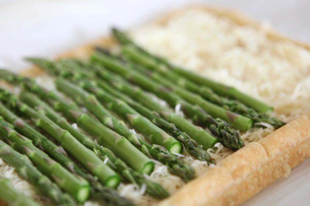 Arrange asparagus in single layer on top of cheese, alternating tips and ends.