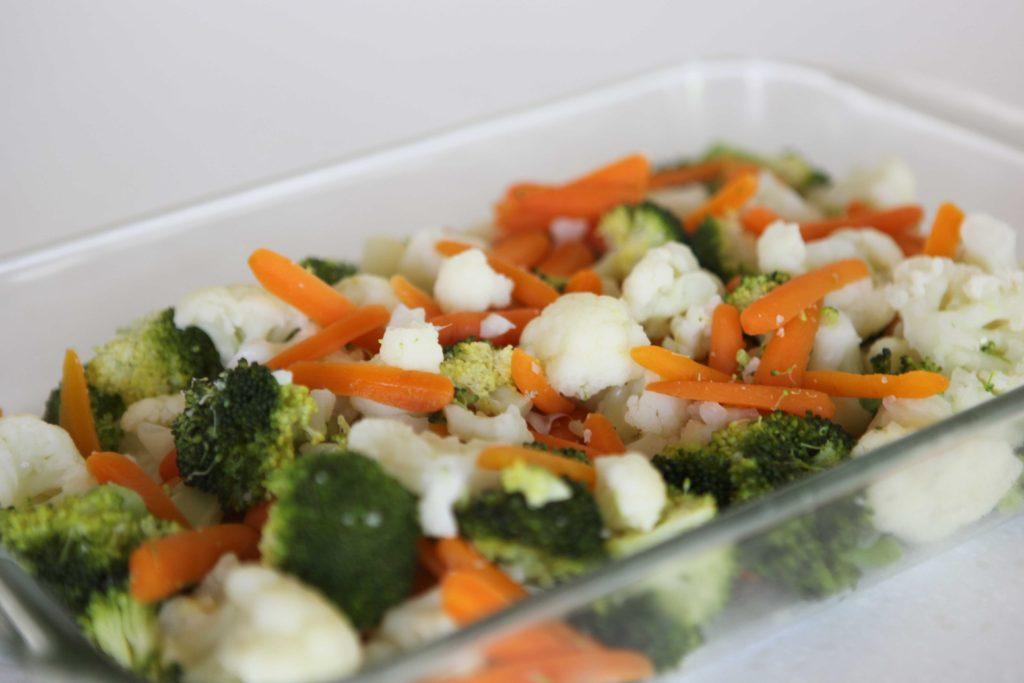 Spread vegetables in bottom of prepared pan.