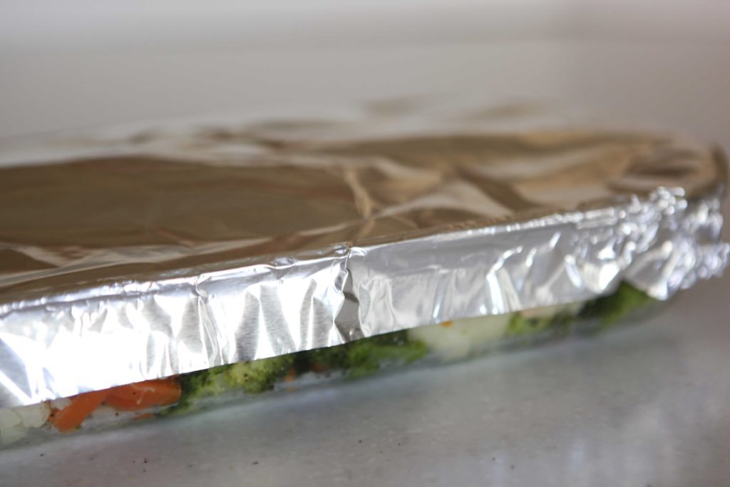 Cover tightly with foil, but be careful that it isn't touching the cheese.