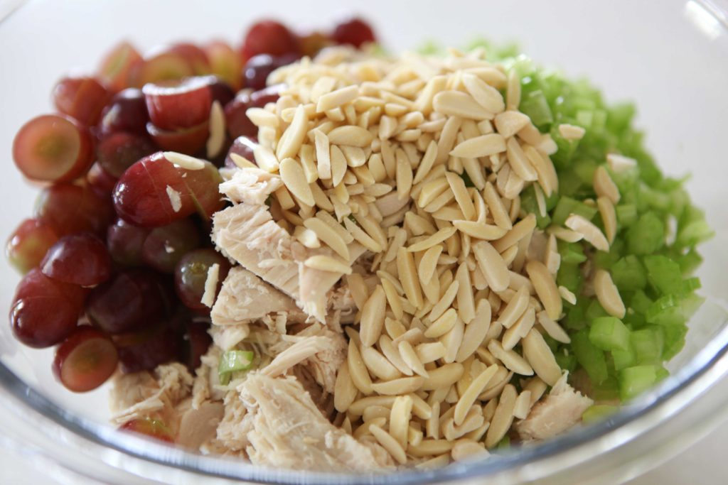 In a large mixing bowl, combine chicken, grapes, almonds, and celery.
