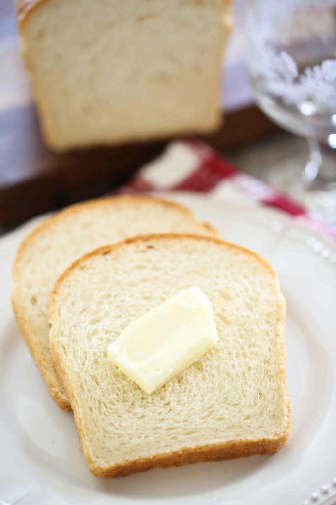 slices of Delicious and Easy Homemade White Bread with butter