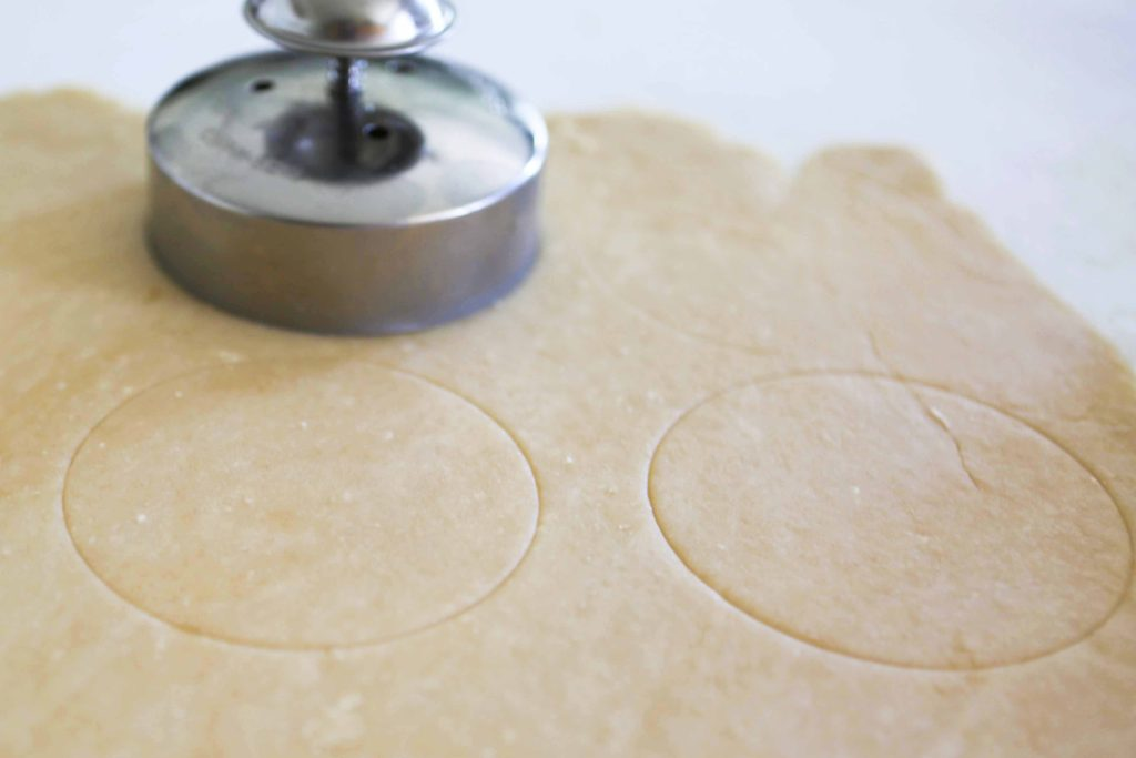 Use your cutter or knife to make light marks on half of the pastry dough.