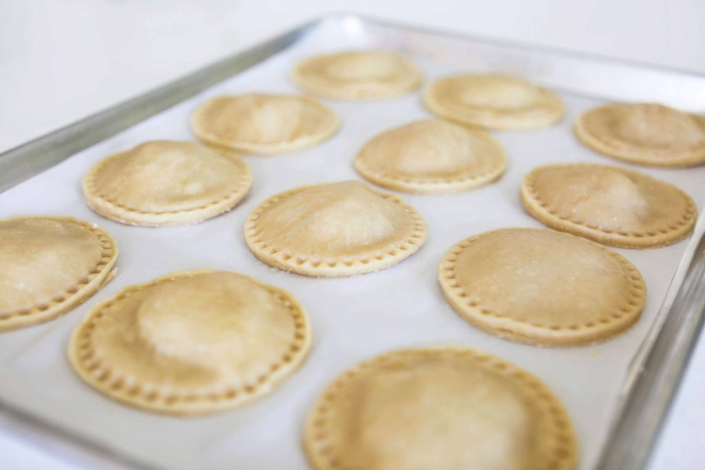 Place the pies on a parchment-lined baking sheet.