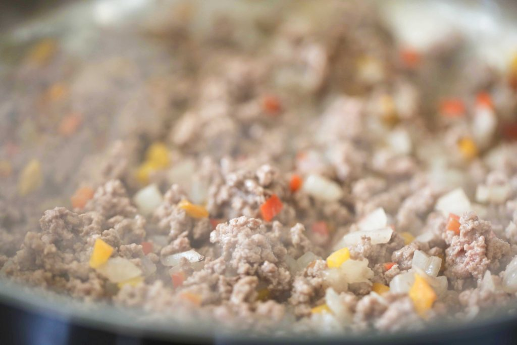 Turn the heat up to medium-high, and stirring constantly, add 1 pound ground beef Cook until well browned (5 to 7 minutes).