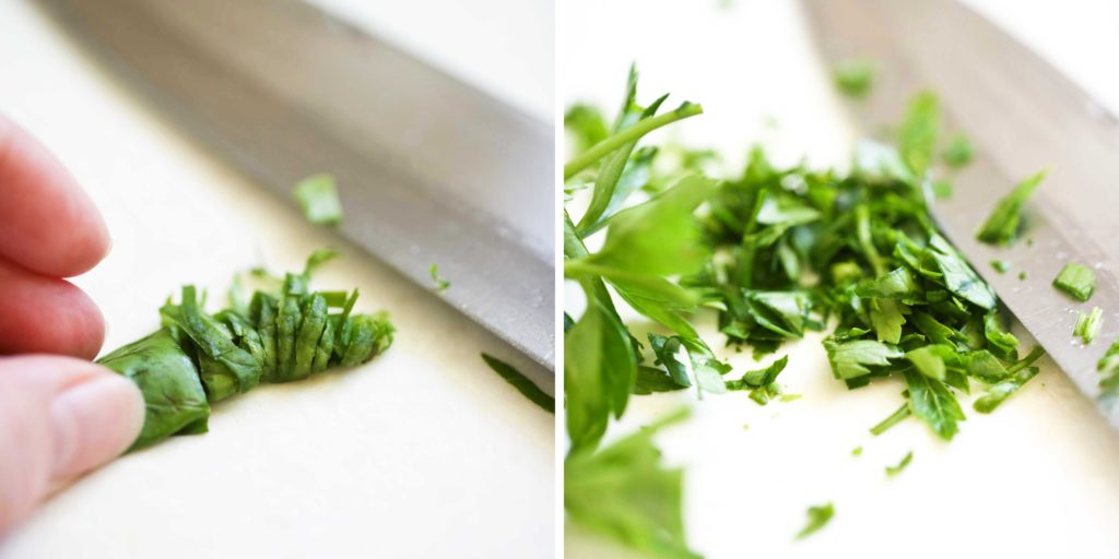 Finely chop fresh basil and parsley. Here's how: Basil ~ stack the leaves on top of eachother, tightly roll into a tube, and thinly slice. Parsley ~ hold the bunch together as close as you can, and chop off the leaves.