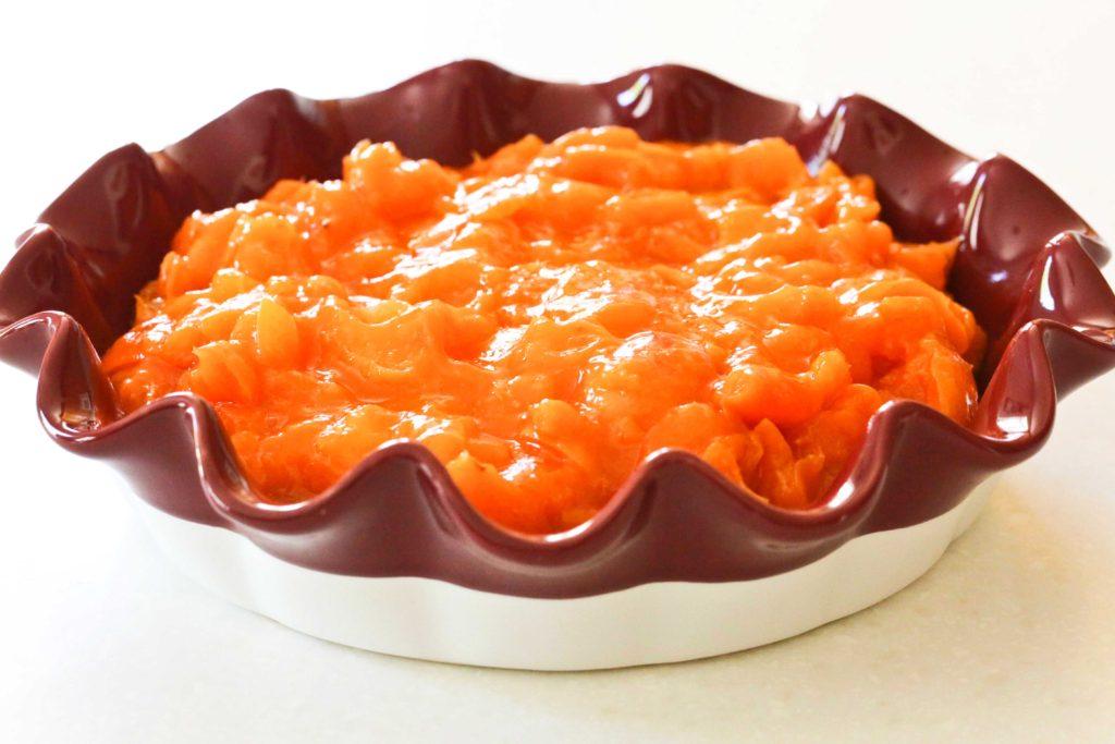 Pour apricot filling into prepared pie plate.
