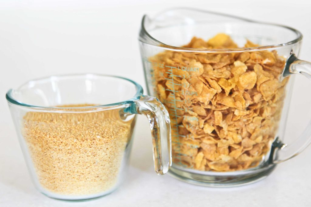 You can make your own Corn Flake crumbs in a food processor. It takes 4 cups of whole Corn Flakes to make 1 cup of crumbs. You can also buy crushed Corn Flakes in the baking aisle.