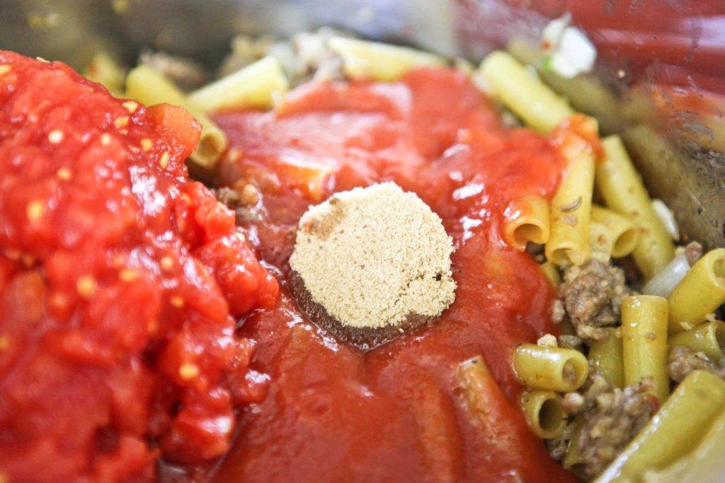 Remove from heat, and add 28 ounce can diced tomatoes 15 ounce can tomato sauce 1 tablespoon brown sugar Stir until completely incorporated ...