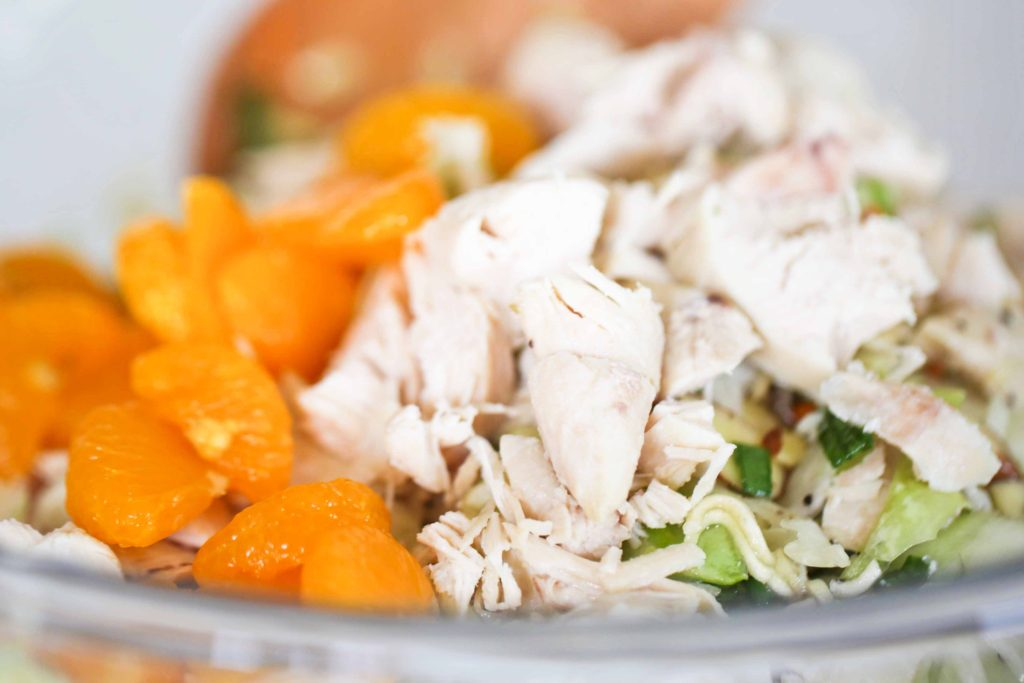 Add 2 cups cooked, chopped chicken breast 1 can (11 ounces) mandarin oranges