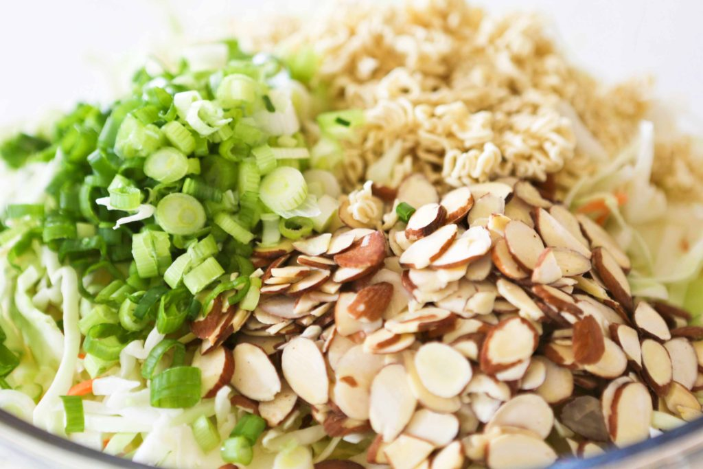 In a large mixing bowl combine 1 bag (16 ounces) shredded cabbage or cole slaw mix 4 green onions, chopped ¾ cup sliced or slivered almonds 1 package dry Ramen noodles, broken into bite-size pieces. ½ cup cilantro, chopped