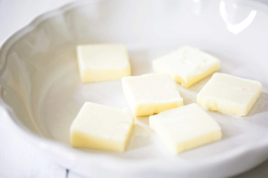 In a pie plate, melt 6 tablespoons butter