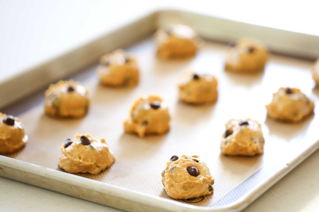Scoop heaping tablespoons of dough onto prepared baking sheets, and bake at 350 degrees for 12-15 minutes.