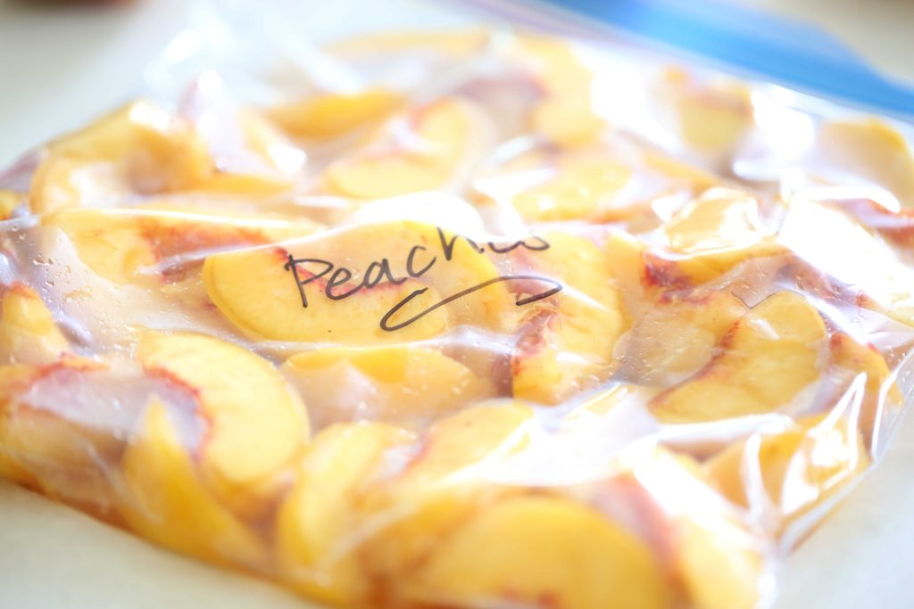 Transfer them to a freezer bag or container, and seal. Make sure to remove as much air as possible. Place them in the freezer, and for best results do the following: Lay bags flat, in a single layer, with space in between so that they will freeze quickly and completely. When frozen solid, the bags can be stacked. Use within 8-10 months.