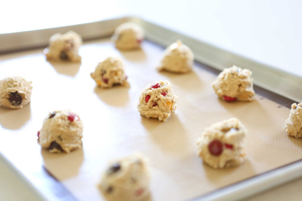 Place rounded teaspoons of dough on cookie sheet.