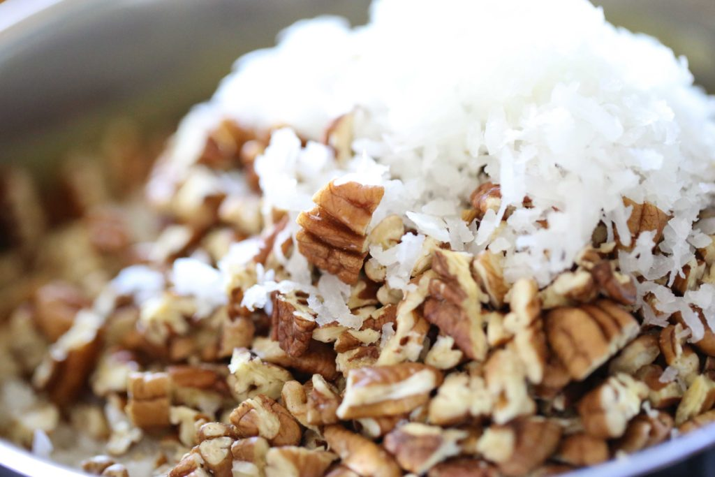 Now add 2 cups grated coconut (7 ounces) 1 ½ cups pecans, finely chopped (7.5 ounces)