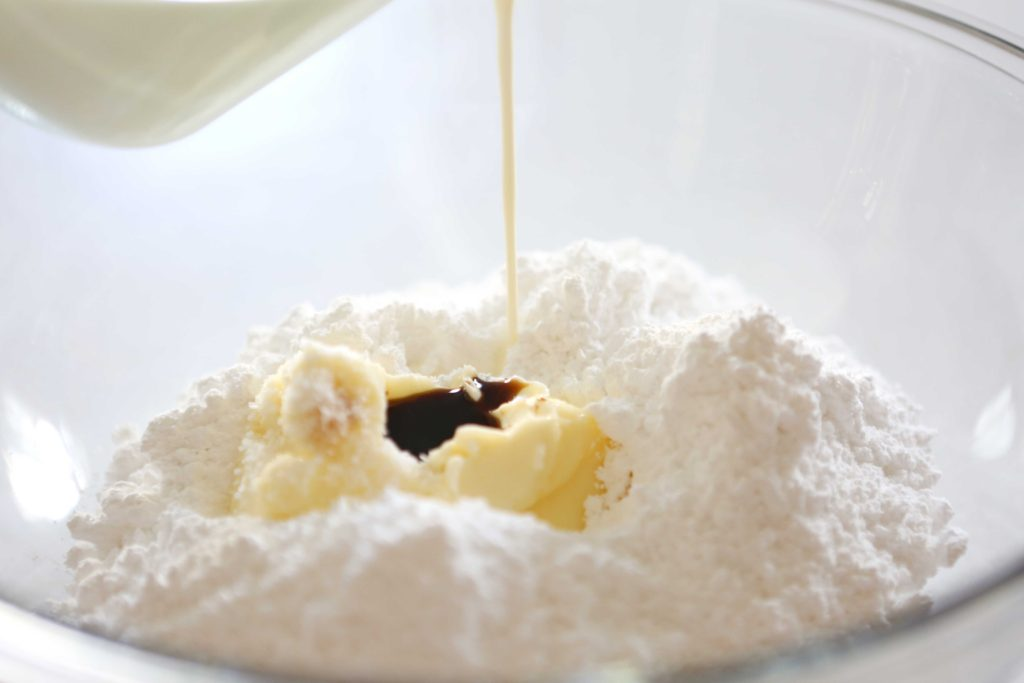 In a large mixing bowl, combine: 4 cups powdered sugar ¾ cup butter, softened ½ cup cream 2 teaspoons vanilla extract ½ teaspoon salt