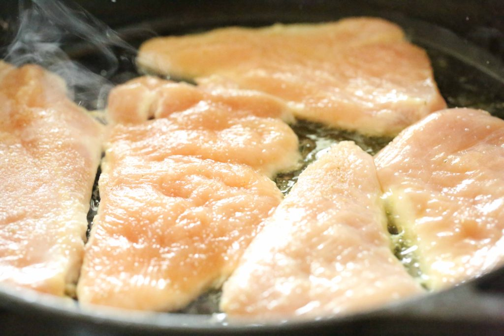 Turn up heat to medium-high, and add chicken pieces.