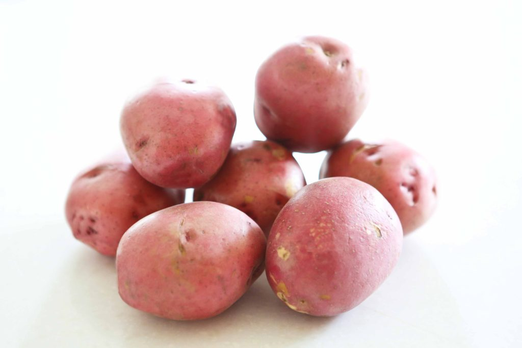 Scrub 3 pounds potatoes If I'm using red or yukon gold potatoes, I don't peel them, but if I use russets, I remove the peels. It's up to you. I've made this recipe with all varieties of potatoes, and it always turns out great.