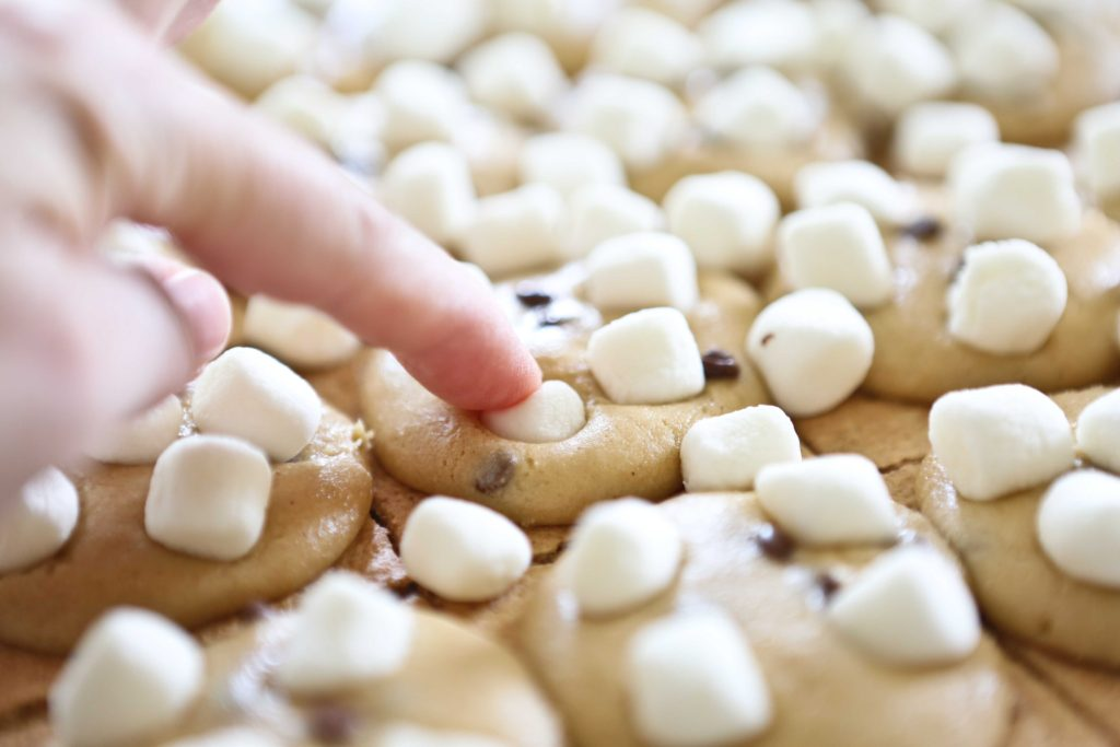 Gently press them into the cookie dough, and return to oven. Bake another 5-6 minutes, until dough is set and marshmallows are toasted.