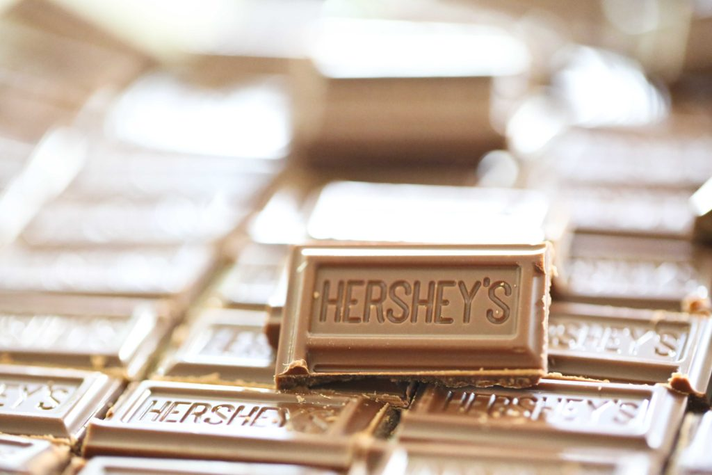 Break 9 regular sized Hershey's bars into 108 pieces, and set aside.