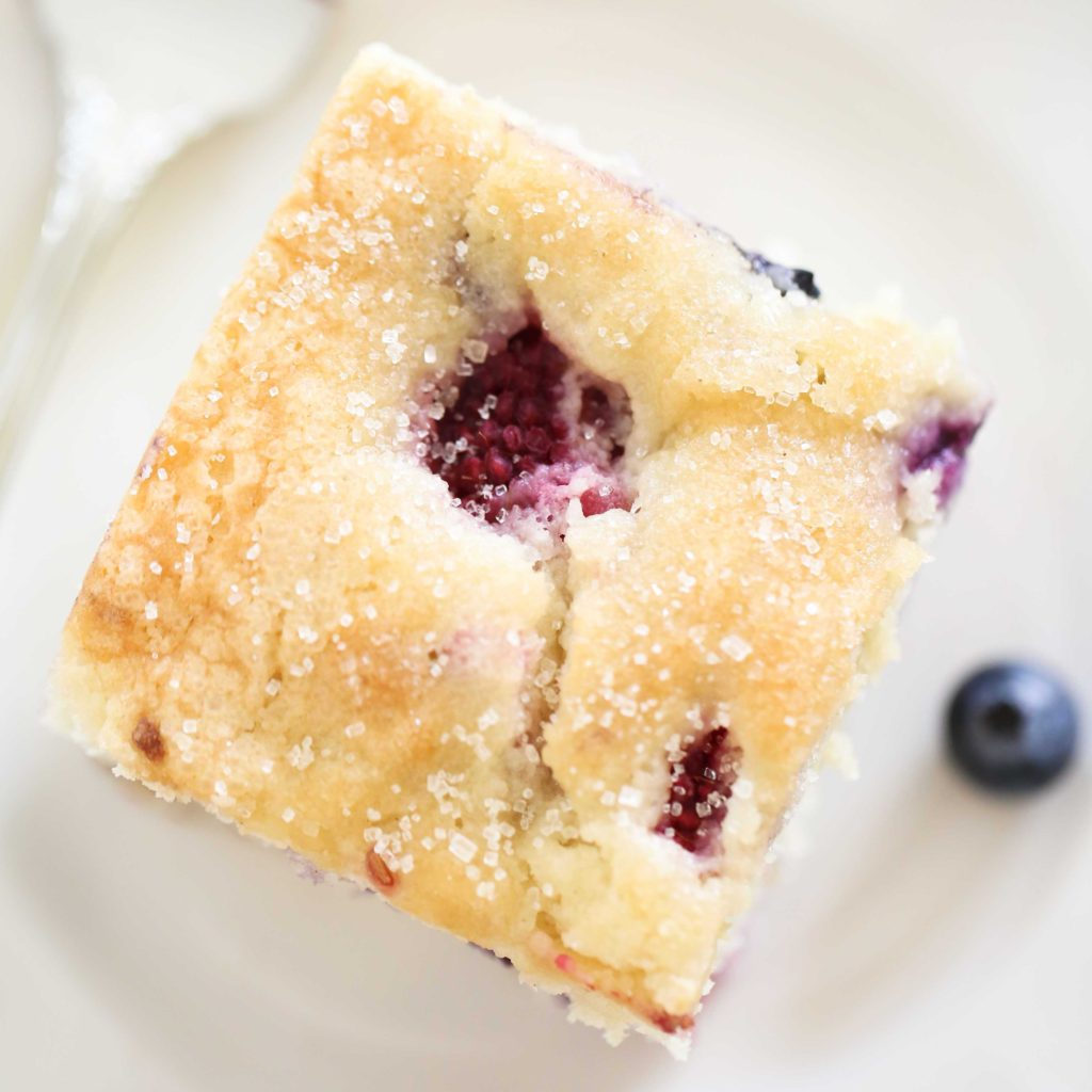 Red, White, and Blueberry Cake made with fresh raspberries and blueberries