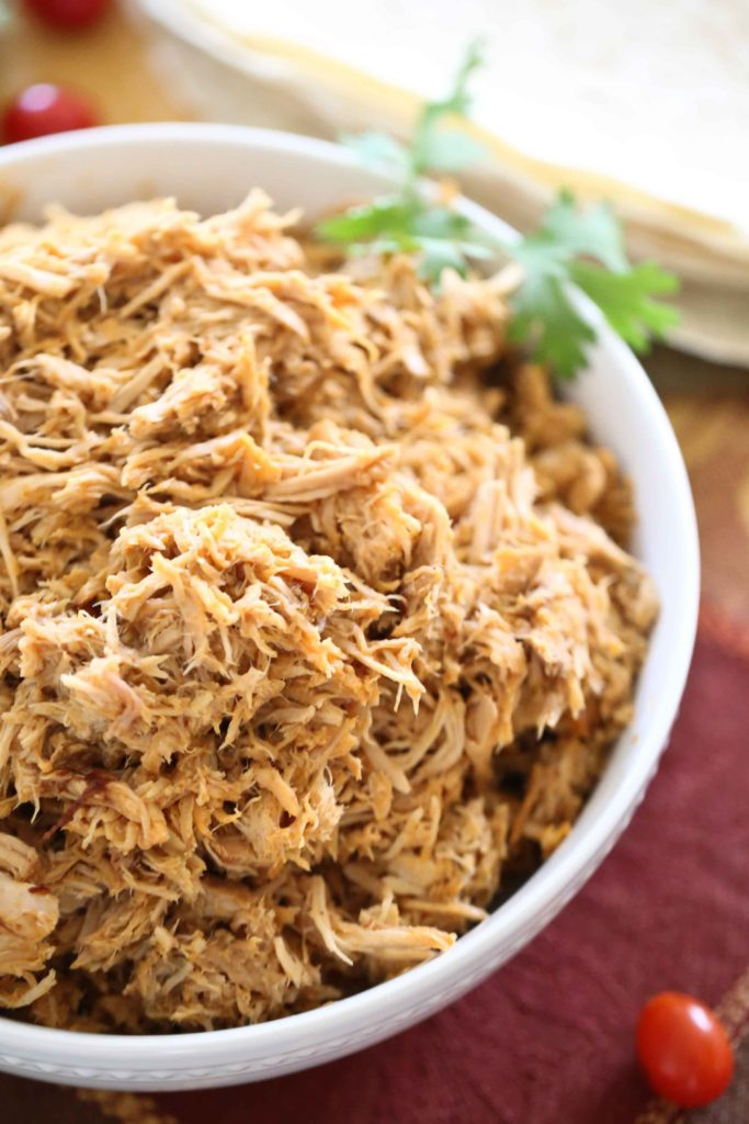 a bowl full of Cafe Rio Style Sweet Pulled Pork for making salads, quesadillas, burritos, or enchiladas