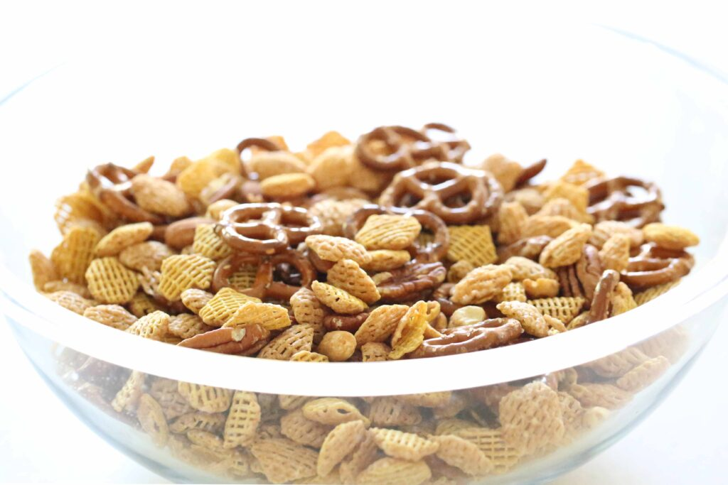 Bowl of ingredients for Nutty Caramel Chex Mix