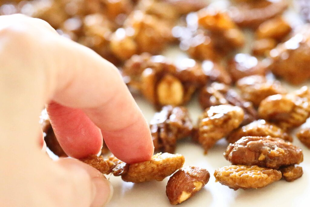 Breaking apart pieces of Nutty Caramel Chex Mix