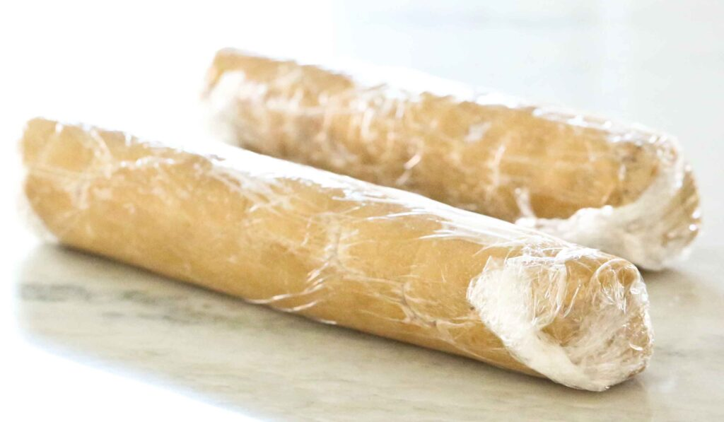 Wrapped rolls of Salted Caramel Cookies dough