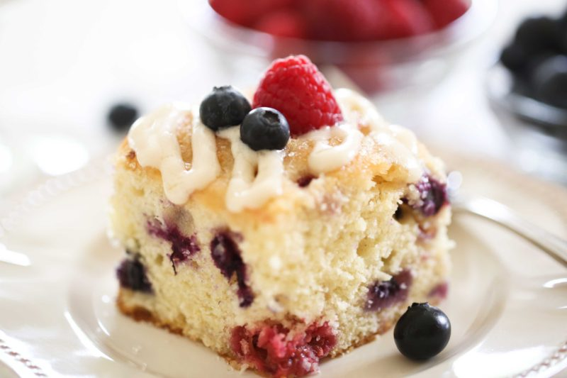 Red, White, and Blueberry Cake made with fresh raspberries, blueberries, and cream cheese glaze